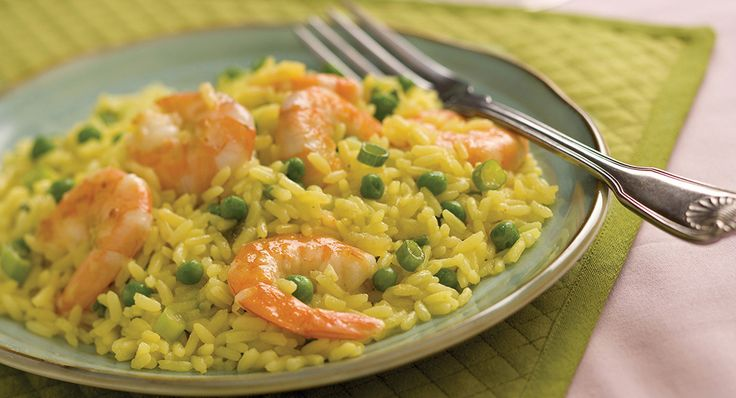 Pair Zatarain's Yellow Rice with tender seared shrimp and sweet green peas for a tasty dish that's perfect for lunch or dinner.
