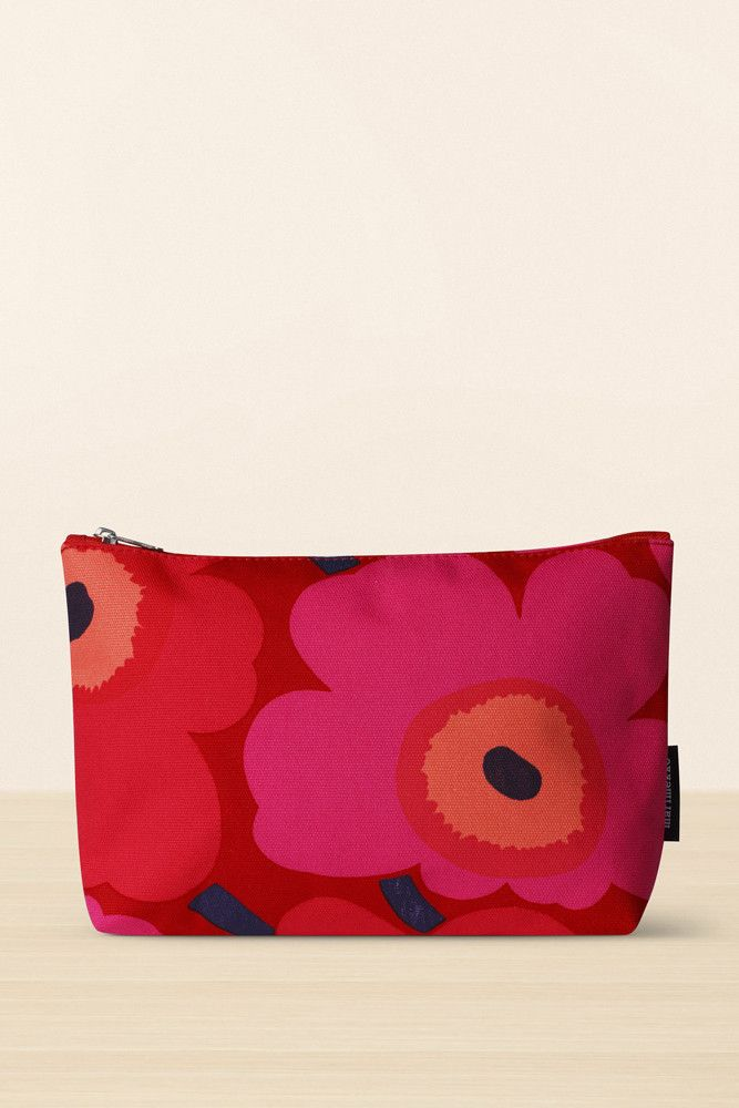 Collection: Continuing 2016 Bags. Print: Pieni Unikko by Maija & Kristina Isola. Material: 100% cotton, PVC coated interior (phthalate-free). Description: Small cosmetic pouch in the Pieni Unikko prin