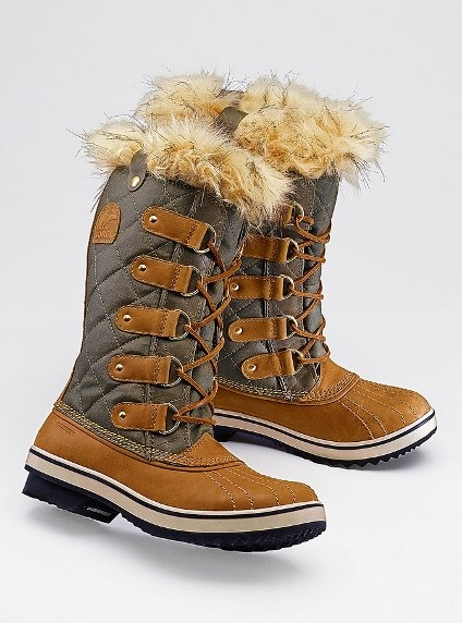 I got these exact boots for an early Christmas present. They look even better on. Waterproof and lined on the inside with fur. Recommend getting a half a size up because they run small. I haven't taken these boots off since I got them, just ask my husband ;)