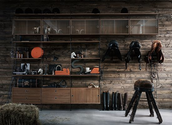 floor panels and wall panels in black. shelves, chest of drawers, cabinets and display cabinets in walnut