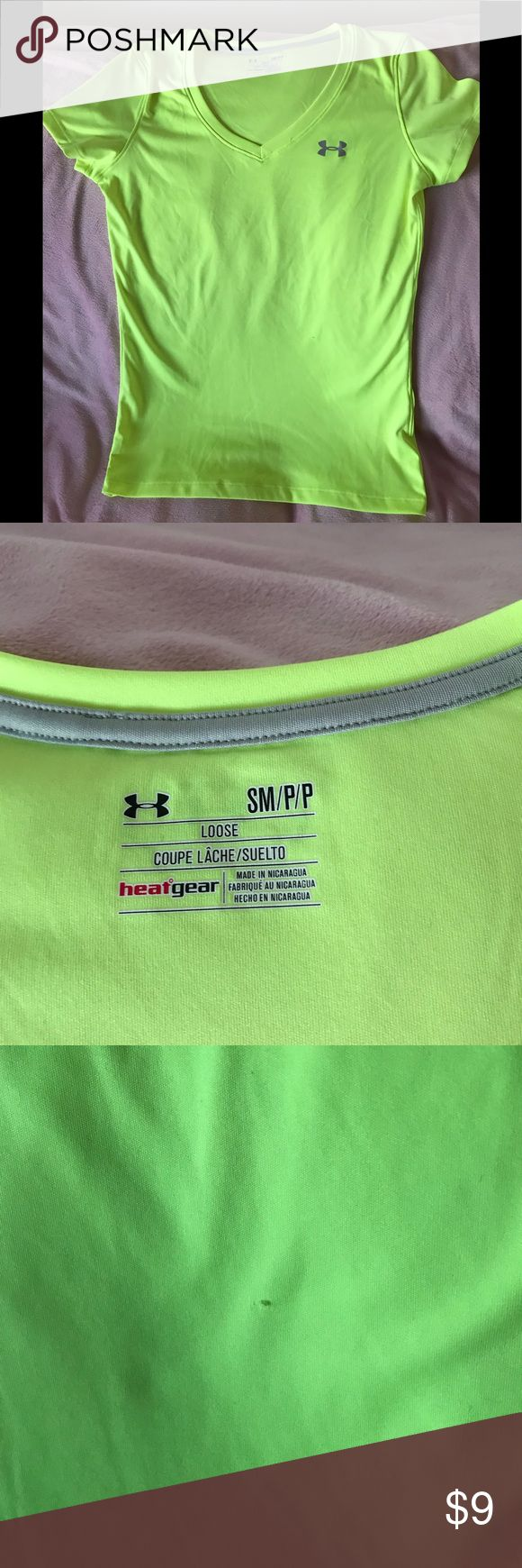 Under Armour shirt sleeve shirt Under Armour short sleeve v-neck shirt. Neon green color. EUC. Ladies size S. One small snag shown in photo. Under Armour Tops Tees - Short Sleeve