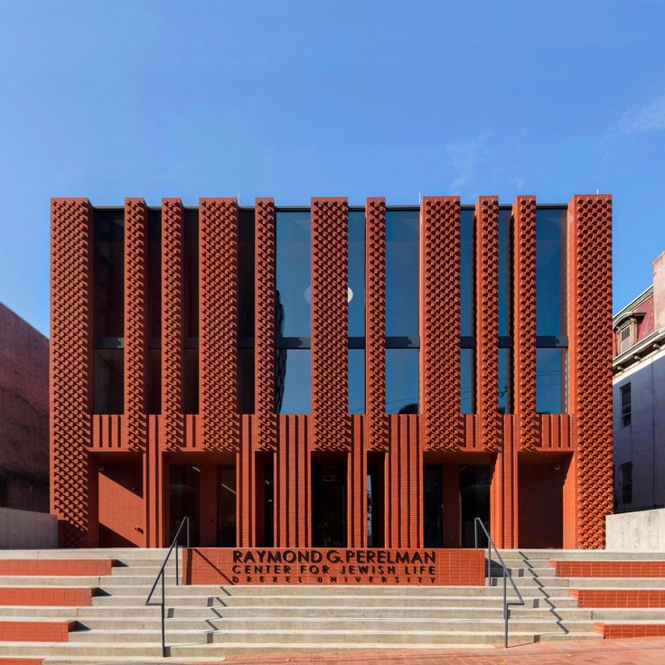 Stanley Saitowitz's firm Natoma Architects has created a Hillel House for Philadelphia's Drexel University, with a red brick facade designed to reference the branched lampstands used in Jewish homes and temples, as well as the striated garments worn during prayer.