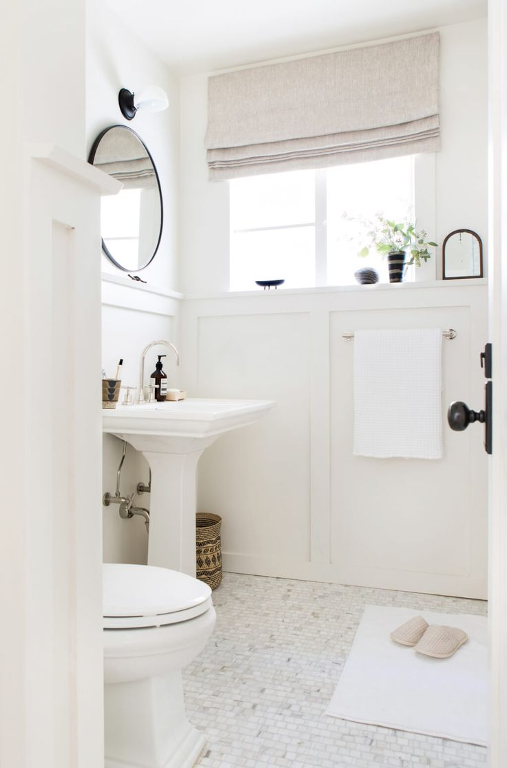 He kept the majority of the bathroom all white by painting it White Dove by Benjamin Moore, and then accented with a lot of tone on tone finishes and small graphic hits of black to keep it interesting.