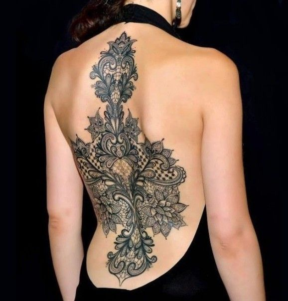 """Intricate and sexy backpiece by Marco Manzo..."" - Found at the Tattoodo blog."