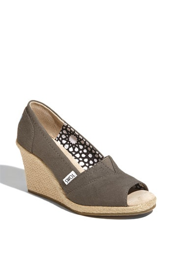 I have these in black, I think I will buy them in grey. Looks great with jeans! TOMS 'Calypso' Canvas Wedge available at #Nordstrom