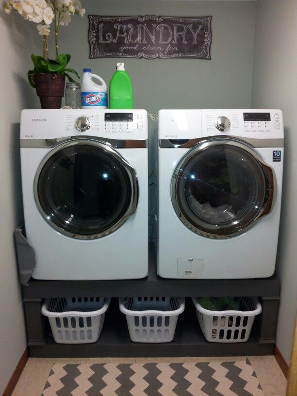 Diy laundry pedestal, small laundry room. My husband built this wooden pedestal for our new washer and dryer. It maximizes the storage space, lifts the set up to where we don't have to bend over use them, and of course looks fabulous!