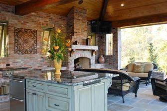 outdoor kitchen island with Spanish cedar cabinets