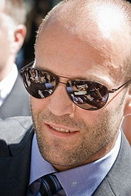 Jason Statham (born 12 September 1967) has done quite a lot in a short time. He has been an Olympic Diver on the British National Diving Team and finished 12th in the World Championships in 1992. He has also been a fashion model, black market salesman and finally of course, actor. He got the audition for his debut role as Bacon in Lock, Stock and Two Smoking Barrels (1998) through French Connection, for whom he was modeling. They became a major investor in the film and introduced Jason to…