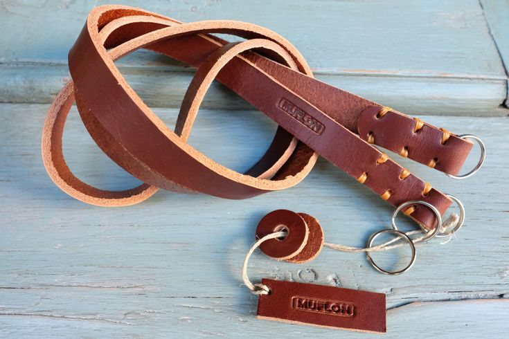 The Nebraska  strap  Classic rugged leather camera strap . Strong, durable, made to last. The Nebraska straps are 100 % handcrafted  from high quality premium bridle leather. Leather with  softness and character without compromising strength. We use bridle leather to create straps  that don't break. The strap  comes in Bourbon  leather with three different stitching colours and four sizes. Perfect for  vintage film cameras , Fuji X , Leica M, Leica Q,  , Sony A7 and other mirrorless cameras.