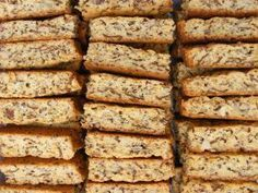 "Everything Rusks 1box all bran. 2 c oats 2 c wh wht flour 4 TBLS bk pdr 1 lb butter 1 bx dark brown sugar 4 c assorted raw nuts 1 box raisins 1 c sunflower seeds 1/2 c flax seeds 1/2 c sesame seeds 1 c pumpkin seeds 1 qrt. butter milk 8 ex lg eggs Mix dry ing Melt butter mix with sugar Beat eggs mix into buttermilk Add dry ingr. To wet, add more buttermilk if needed Make Slice marks 1""x2"" 350 1-1 1/2 hrs Dry in warm oven until dry."