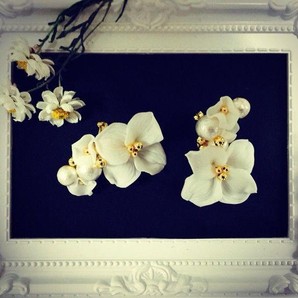 春にぴったりのお花のイヤーカフス、ブライダルにもオススメです(^^)お花一つ一つ手作りしています。接着にはテグスとボンドを使っています。取れないよう作っていま... ハンドメイド、手作り、手仕事品の通販・販売・購入ならCreema。