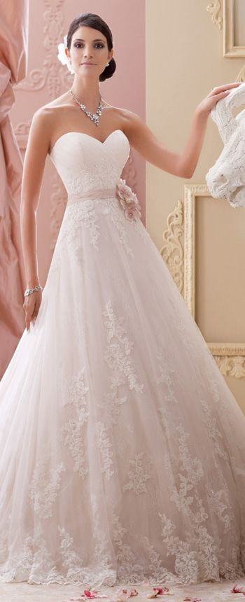 This strapless a line lace wedding dress with allover soft lace features hand-beaded corded lace appliqué and tulle over satin with a sweetheart neckline.