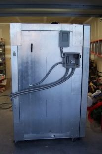 Homemade powder coating oven with a 3'x3'x5' interior. Oven is heated by two 3100w heating elements with PID controls