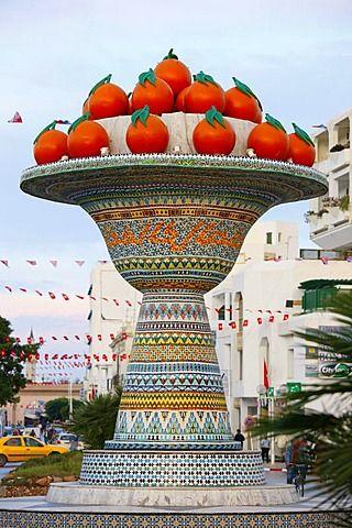 Artificial fruit bowl with oranges, street monument, mosaic, Hammamet, Tunisia…