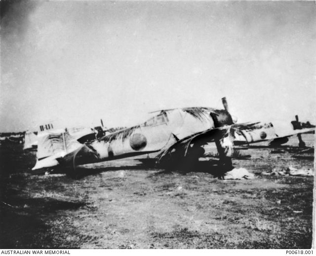 "Kota Bharu, Malaya, c.1942. Camouflaged A6M (Zero) fighter aircraft of 22 Air Flotilla, Japanese Navy, on airstrip at Kota Bharu. This unit flew into Kota Bharu from South Vietnam and operated along the East Coast of Malaya including flying ""top cover"" for the succe"