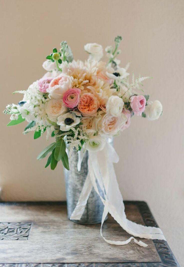 loose bridal bouquet of  café au lait dahlias, white anemone, light pink kiera garden roses, Juliet garden rose, white stock, light pink ranunculus, white ranunculus, white astilbe,bay leaf & dusty miller wrapped in cream silk ribbon
