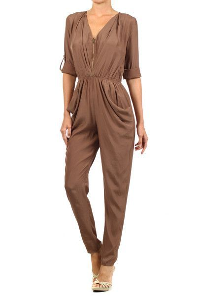 The jumpsuit you've been searching for with long sleeves and relaxed harem pant. In this creamy mocha color and draped pockets this jumpsuit is chic and on trend. Details: - Elasticized waist - Keyhol