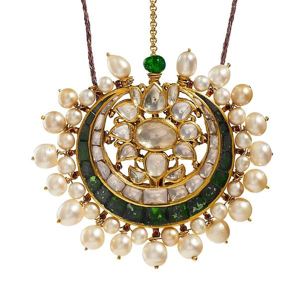 Forehead or Turban Ornament (tika) Object Name: Forehead ornament Date: ca. 1900 Geography: North India, Punjab Medium: Gold, set with emeralds and diamonds, with attached pearls; enamel on reverse