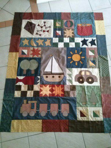 For my nephew. Just waiting to be quilted.  Pattern available at Rose Patchwork Cottage.