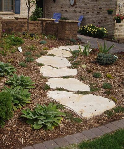 Paver Pathway Hosta And Mulch Flowers Grass And Rocks