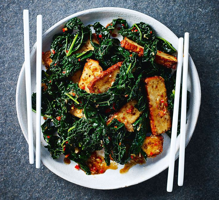 Try Ching-He Huang's healthy Chinese recipe for smoked tofu with kale.