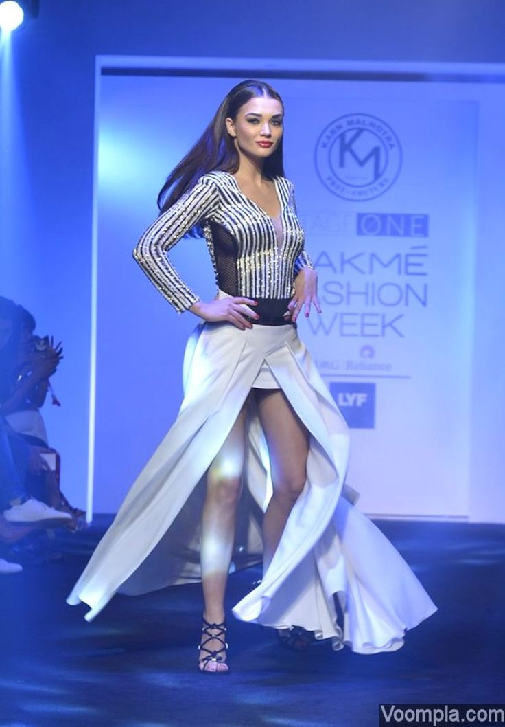 Amy Jackson looks sexy as she shows off her toned legs while modelling at the Lakme Fashion Week. via Voompla.com