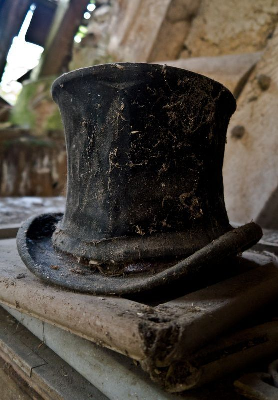 A forgotten top hat among the ruins of a house.