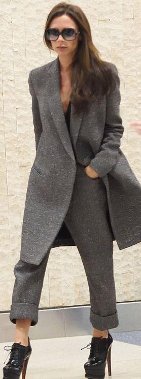 Victoria Beckham: Coat and pants – Victoria Beckham  Sunglasses – Culter and Gross  Shoes – Alaia