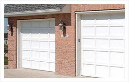 CHI Metal Wood Look insulated Doors thru Cedar Hill OverHead Garage Door Company.