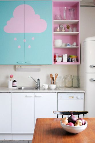 a pink rain cloud on cabinets, pink interior (blue background on cabinet door).  cute idea