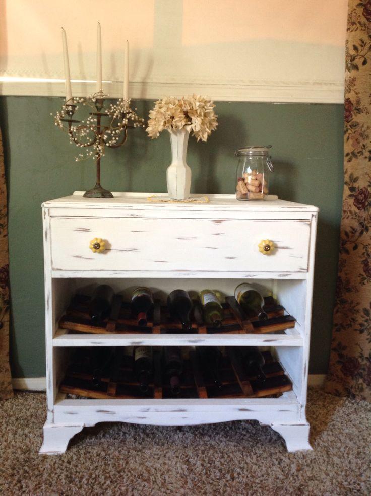 Old dresser with wine barrel stave wine racks
