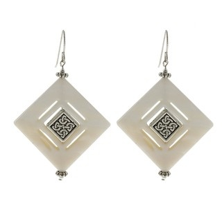 @Overstock - Beautiful cut-out pieces of white mother of pearl are accented with pewter aztec designs in this pair of earrings. These stunning earrings will spice up any ensemble and dangle from hooks of sterling silver.  http://www.overstock.com/Main-Street-Revolution/MS-DJ-Casanova-Pewter-and-Silver-Mother-of-Pearl-Aztec-Diamond-Earrings/6047570/product.html?CID=214117 $22.49