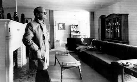 Truman Capote in the living room of the Clutter ranch. In Cold Blood.