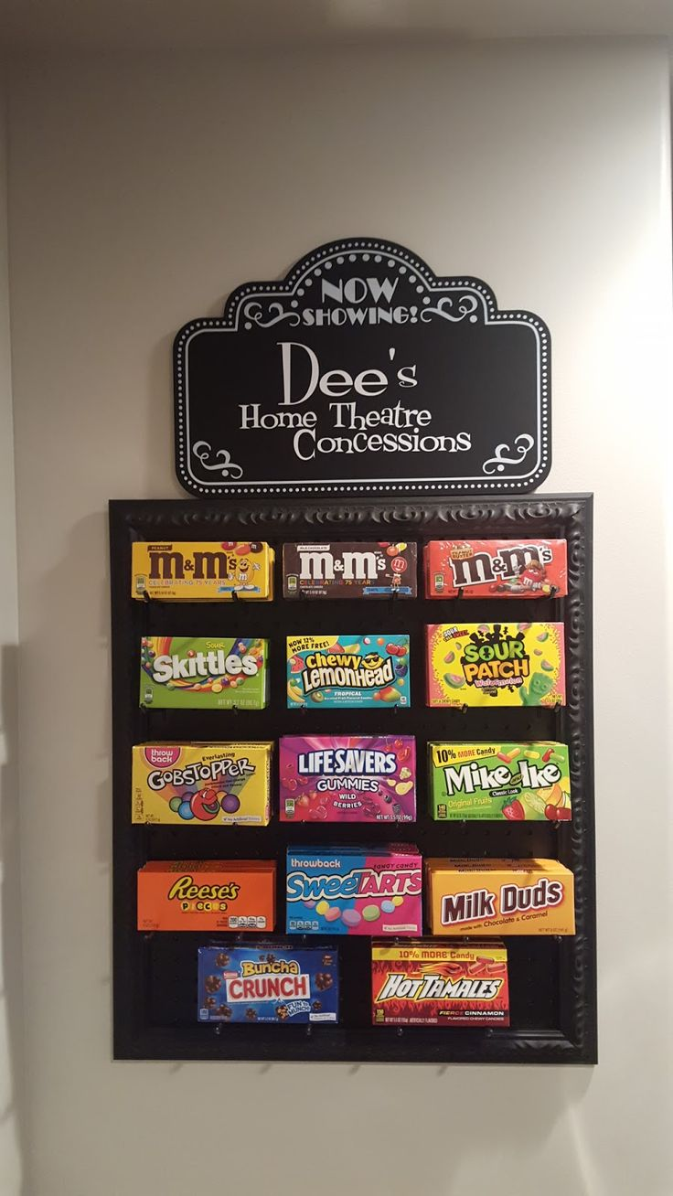 Peg board concession stand for movie night at home. So cute! Via Westcreek.