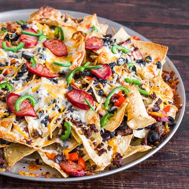The ultimate recipe for irresistible, mouth-watering nachos, loaded with ground beef, chorizo and a Southwestern three cheese mix.