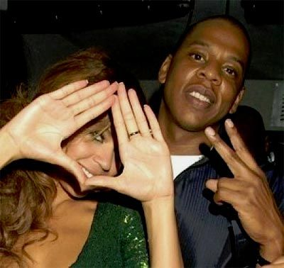 beyonce and her husband Jay Z...throwing illuminati signs. Jay Z's clothing line rocowear is all about baphomet, the eye, triangles and the satanic bible....