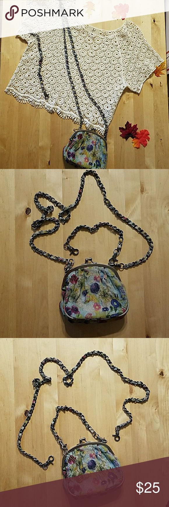 "Big Buddha floral fabric pruse Big Buddha Santa Barbara floral fabric with two length straps with sturdy claw closures. The chain strap has fabric interwoven into the links that gives this a unique look.  Body is 60% Cotton 40% Linen Lining 100% Polyester Approximate measurements shown in pics 7""×5.5""×1 5""  strap drops 23"" & 5"" Big Buddha Bags"