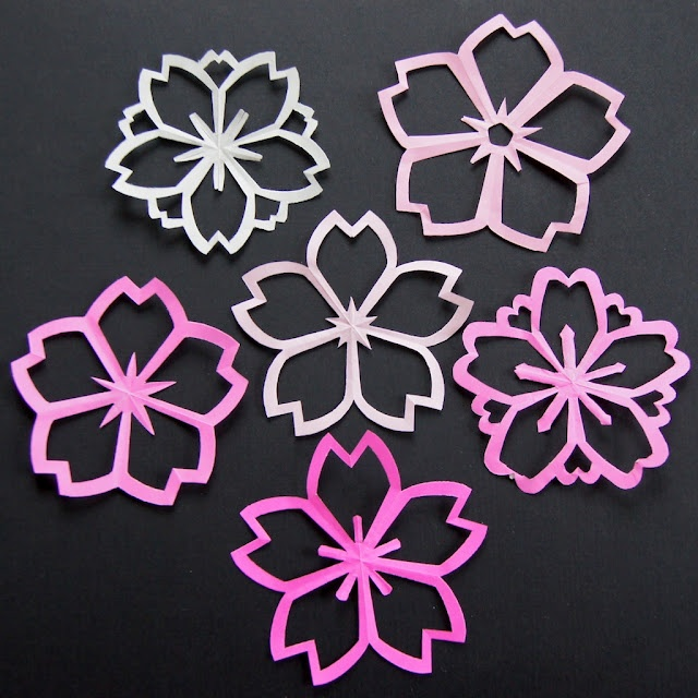 "Nice tutorial on omiyageblogs.com to make cherry blossom ""kiragami"".  I love cherry blossoms :)"