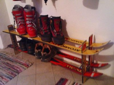 Skis made into a ski boot rack.             Gloucestershire Resource Centre http://www.grcltd.org/home-resource-centre/