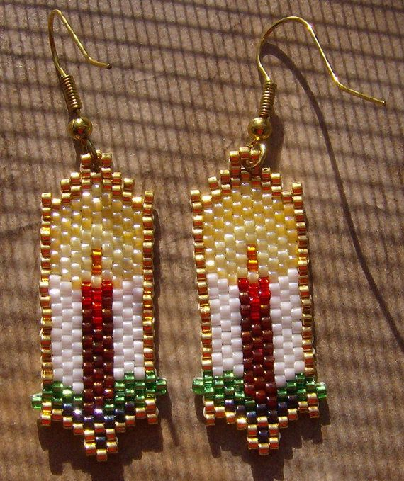 """Christmas Candle Earrings Hand Made Seed Beaded. These pretty Christmas Candle earrings are done in the brick stitch with size 11 glass seed beads. The colors that I have used are blue iris, 22k gold, silver lined green. silver lined red, dark red, pearl white, pale yellow pearl,yellow luster, and silver lined squash.They measure 1 3/4"""" long."""