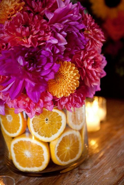 Summer centerpieces! You can use lemons, oranges, limes or grapefruits. Slice fruit and arrange inside glass vase. Combine with bright flowers for extra flare, or white flowers to accentuate the colors of the fruit.