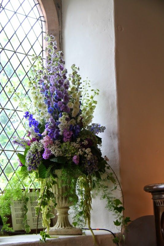 The Spectacularly Beautiful, Whimsical, Bohemian Wedding An exquisite Urn of fresh flowers on the windowsill