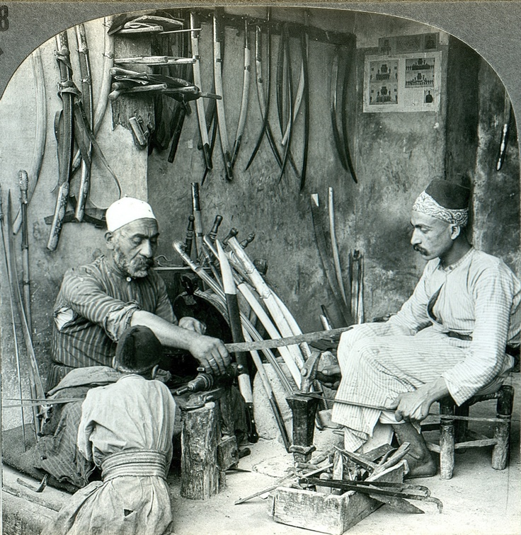 A Damascus bladesmith in his workshop, c. 1900. Damascus steel was famous for centuries as unparalleled for swordmaking. Damascus steel was created from wootz steel, a steel developed in India around 300 BC. Damascene swords are characterized by distinctive patterns of banding and mottling reminiscent of flowing water. The blades are tough and can be honed to a sharp, resilient edge.