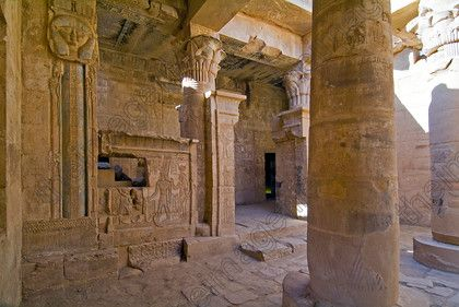 Ptolemaic Temple Interior EG051838JHP Deir al-Madinah el-Medina Luxor Egypt West Bank Temple Hathor Columns Photograph Interior is located on the West Bank of the River Nile at Luxor lies to the west of Qurnet Murai hill and is the location of a workman's village with the remains of houses, streets and to the north a Ptolemaic Temple and other chapels. The temple is inside a mudbrick enclosure wall with good example of pan bedding and its large walls are obvious when looking over the village…