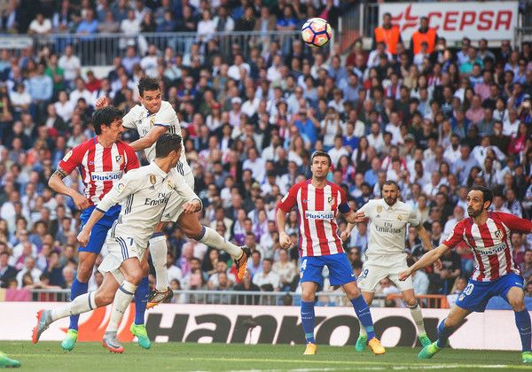 Pepe of Real Madrid scores Real's opening goal during the La Liga match between Real Madrid CF and Club Atletico de Madrid at Bernabeu   on April 8, 2017 in Madrid, Spain.