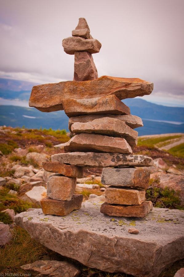 An Inukshuk at the top of Gros Morne, the highest peak in Newfoundland and Labrador, Canada; ...INUKSHUK (or inuksuk) is a stone landmark or cairn built by people who live in the Arctic Circle (from Alaska to Greenland); photo by Michael Crerar, via 500px
