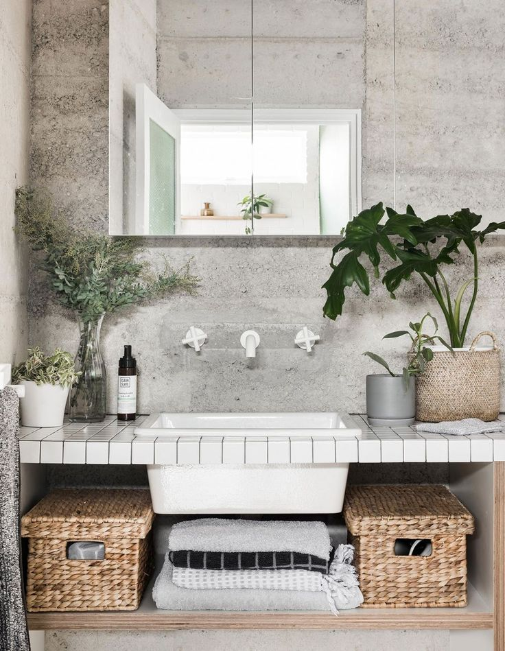 The bathroom is a lesson in simplicity… Cabinetry is by Raw Edge Furniture and tapware by Astra Walker. The mirror cabinetry was fitted by Peter. The couple prefer to use locally made vegan body products by Clean Slate . Photography – Dion Robeson, styling – Anna Flanders.