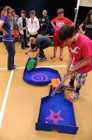 Press (Clyde, TX): Students play on a cardboard putt-putt course at Clyde Junior High School on Tuesday, which was designed and built by high school kids.