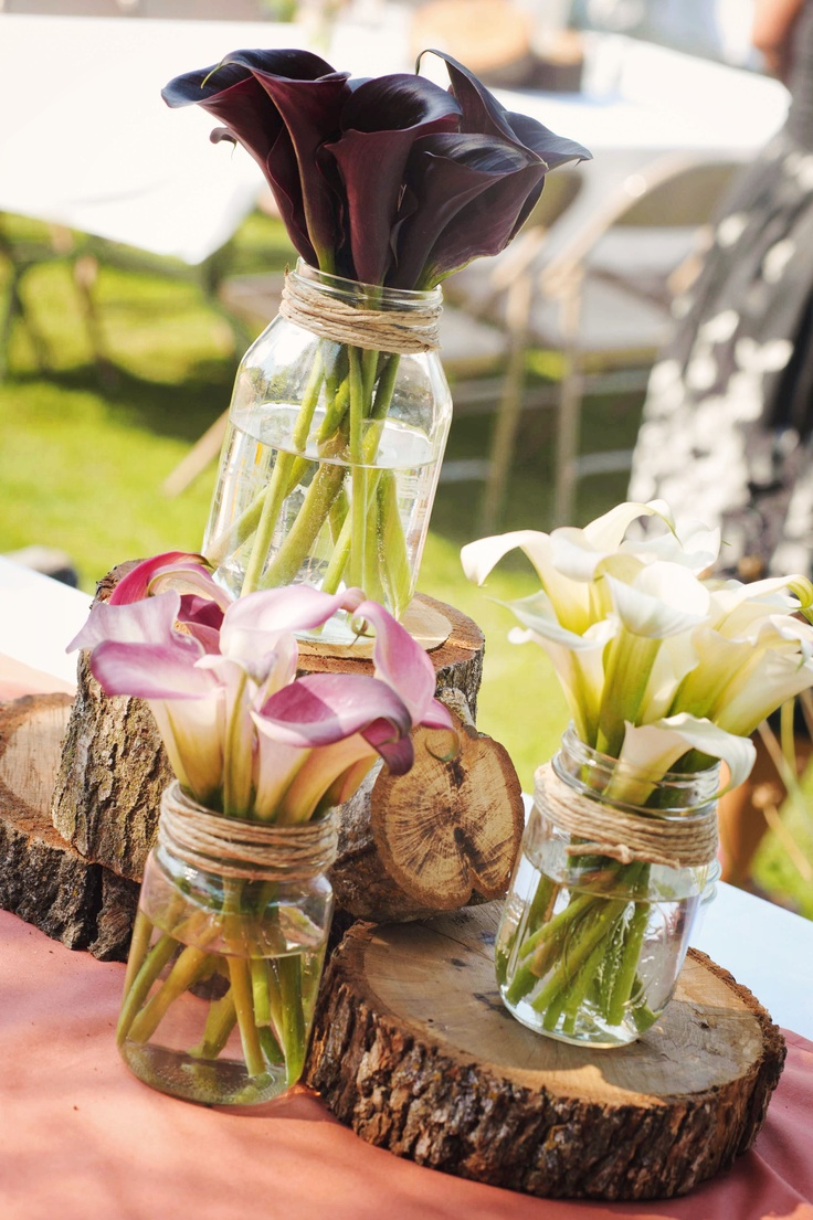 Simple centerpieces- change the flowers to hydrangea and peonies. Wood, mason jar love