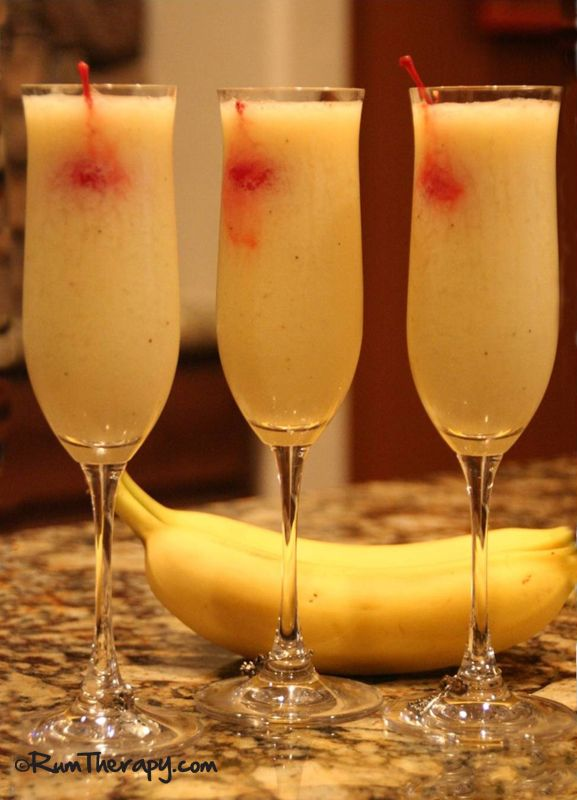 Banana Daiquiri (1.5 – 2 oz light rum 1 Tbsp triple sec 1 banana 1.5 oz lime juice 1 tsp sugar 1 cup crushed ice Maraschino Cherry for garnish)